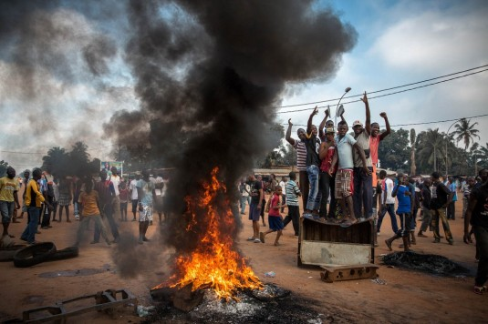 Bangui, Central African Republic. Demonstrators gather in the capital Bangui to protest following the killing of a judge by Séléka militia. Half an hour after this photo was taken, Séléka gunmen fired into the crowd, killing two people and wounding another. Photographer: William Daniels