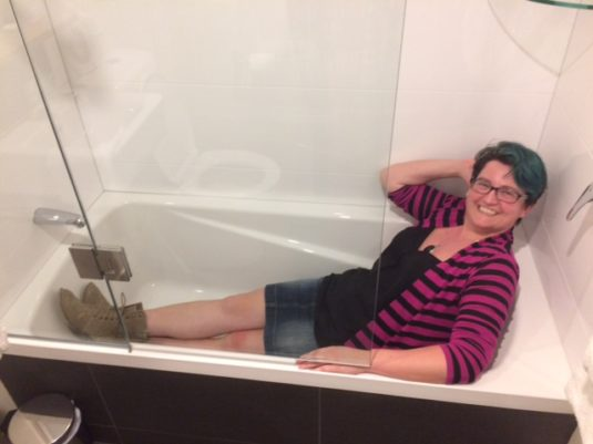 an average size person in a fairly small bathtub