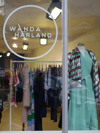 window of wanda harland showing colourful clothing