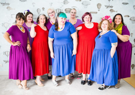 group of fat women in super comfy knit dresses
