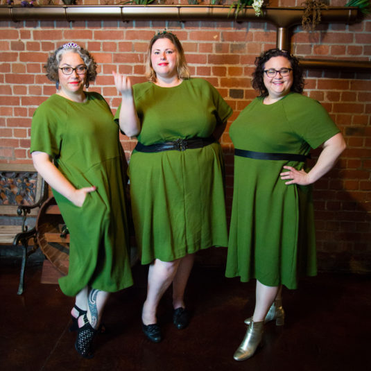 three fat babes in green dresses